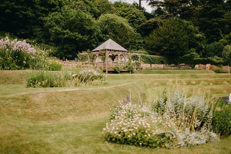 Outdoor Wedding Ceremony Arbour | DIY Rustic Tipi Wedding at Riverhill Gardens, Sevenoaks | Frances Sales Photography