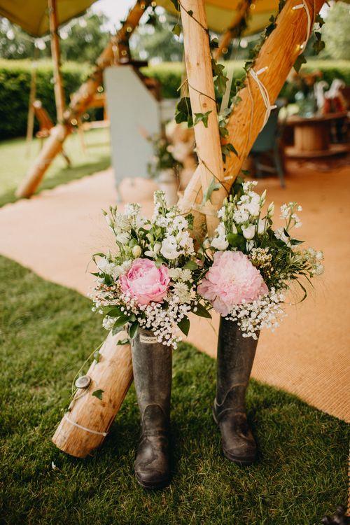 Pink Peony & Gypsophila Flower Filled Wellington Boots Wedding Decor | DIY Rustic Tipi Wedding at Riverhill Gardens, Sevenoaks | Frances Sales Photography