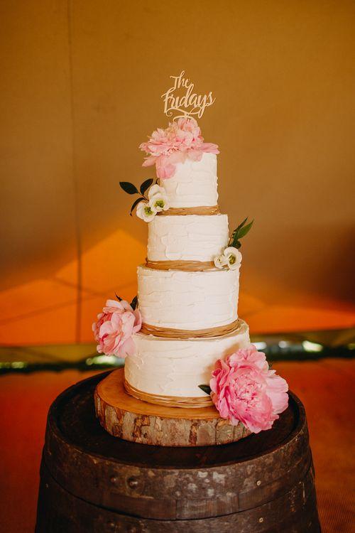 Cream Frosting Wedding Cake on Tree Slice Cake Stand | Wedding Decor | DIY Rustic Tipi Wedding at Riverhill Gardens, Sevenoaks | Frances Sales Photography