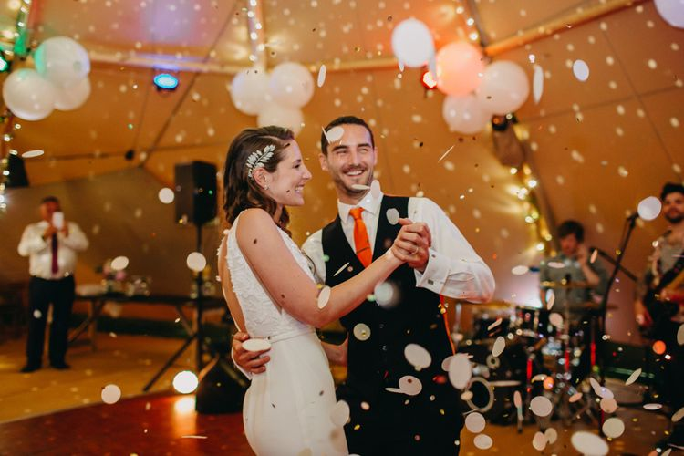 Confetti Bomb First Dance | Bride in Halo & Wren Wedding Dress | Groom in Moss Bros. Suit | DIY Rustic Tipi Wedding at Riverhill Gardens, Sevenoaks | Frances Sales Photography