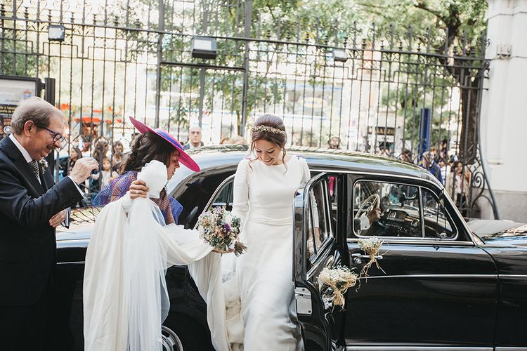 Bride Arriving in Wedding Car in Nnavascues Embroidered Back Wedding Dress