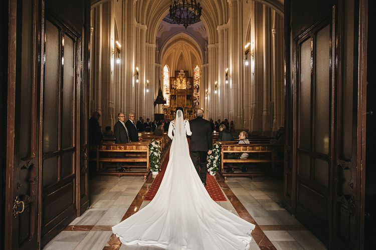 Bridal Church Entrance in Nnavascues Embroidered Back Wedding Dress