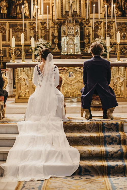 Church Wedding Ceremony with Bride in Nnavascues Embroidered Back Wedding Dress and Groom in Navy Suit