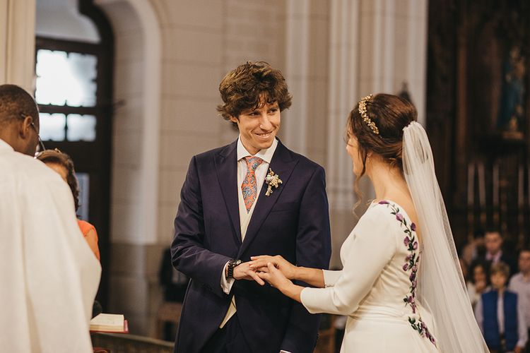 Church Wedding Ceremony with Bride in Nnavascues Embroidered Back Wedding Dress and Groom in Navy Suit Saying Their Vows at the  Altar