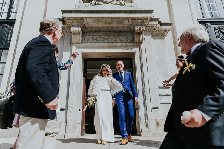 Confetti Exit | Bride in Agata Wojtkiewicz Atelier Bridal Gown | Groom in Blue Paul Smith Suit | Stylish Intimate London Elopement at Islington Town Hall & The Elk in the Woods | Joasis Photography