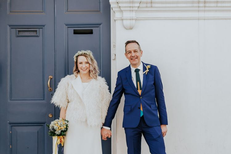 Bride in Agata Wojtkiewicz Atelier Bridal Gown | Yellow Manolo Blahnik Shoes | Groom in Blue Paul Smith Suit | Stylish Intimate London Elopement at Islington Town Hall & The Elk in the Woods | Joasis Photography