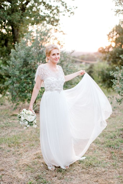 Bride in Beaded Marchesa Adele Wedding Dress from the Eternal Heart Collection.