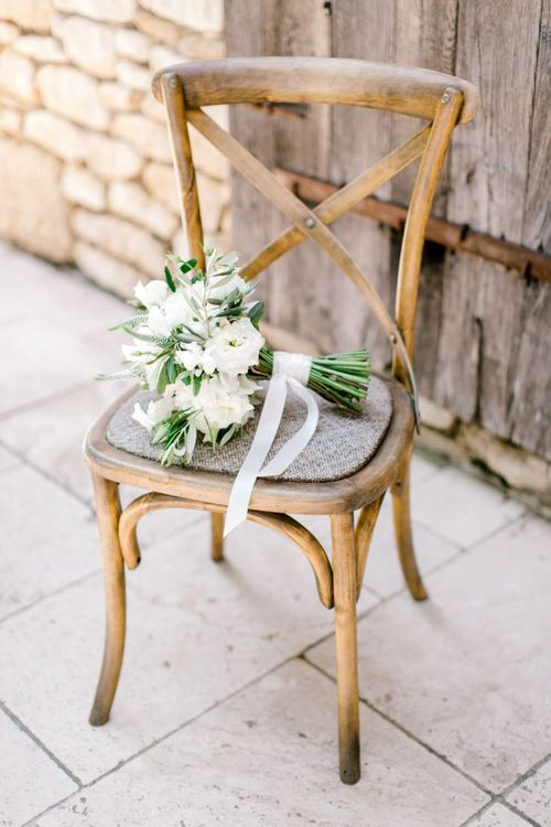 Hand Tied White and Green Wedding Bouquet on a Chair