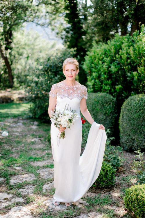 Bride in MarchesaWedding Dress with Beaded Top