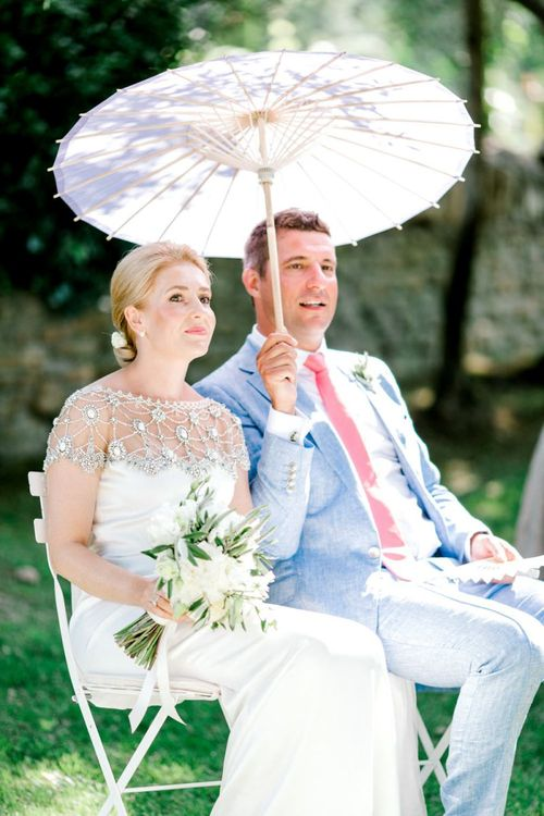 Bride in Beaded Marchesa Wedding Dress and in Groom Light Blue Suit