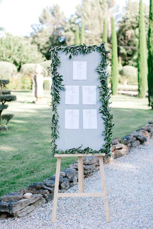 Grey Table Plan Framed in Foliage Garland