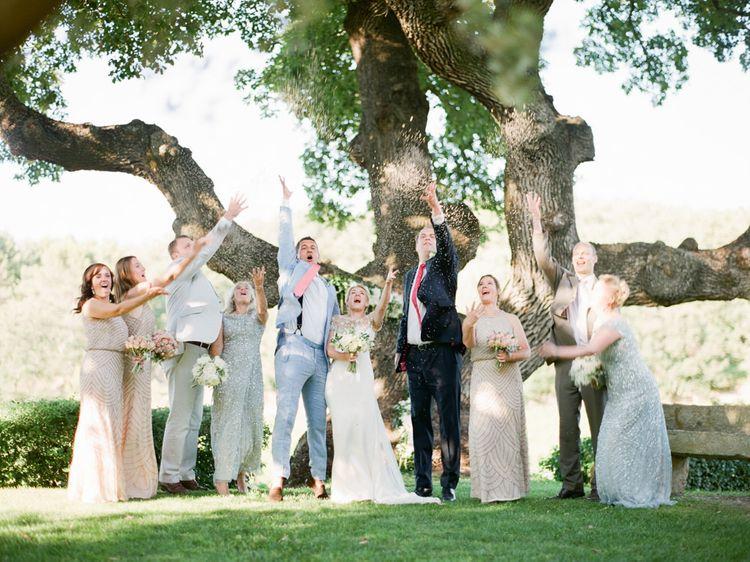 Wedding Party Portrait Throwing Confetti