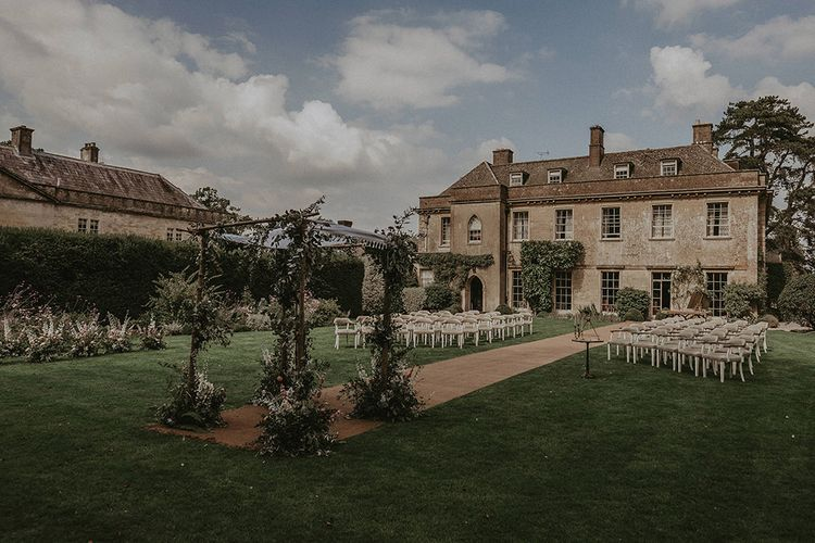 Outdoor Wedding Ceremony at Babington House with Floral Chuppa