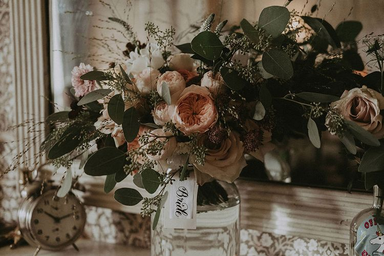 Full, Loose and Asymmetrical Bridal Bouquet of Blush and White Flowers with Greenery
