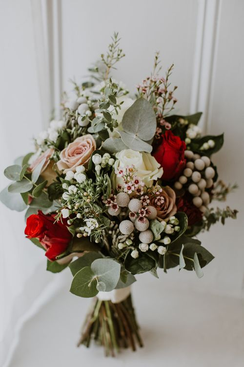 Winter Wedding Bouquet with White Green & Red Flowers | Rustic Cripps Barn Winter Wedding | Alexandra Jane Photography