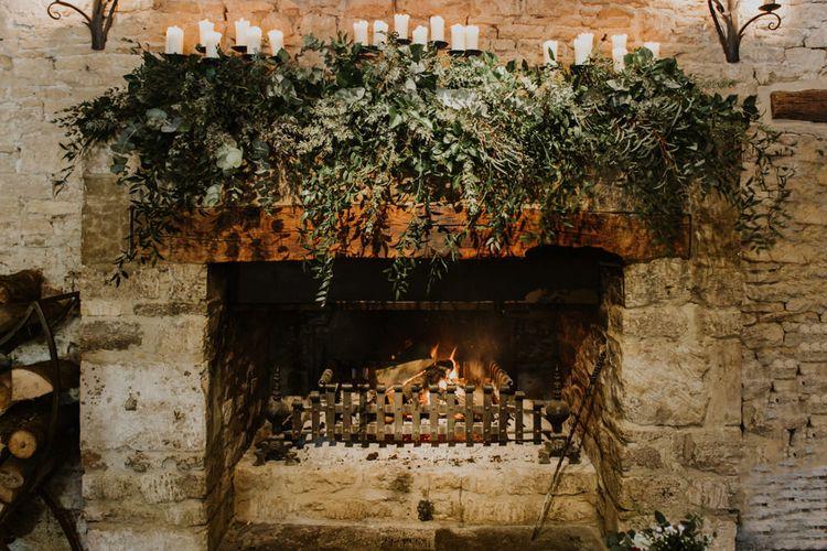 Grand Fireplace with Greenery Garland | Rustic Cripps Barn Winter Wedding | Alexandra Jane Photography