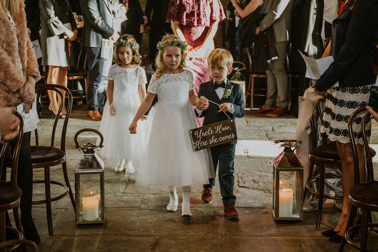Wedding Ceremony | Flower Girl & Page Boy Entrance with Her She Comes Sign | Rustic Cripps Barn Winter Wedding | Alexandra Jane Photography