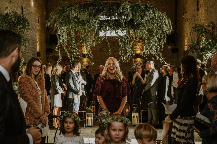 Wedding Ceremony | Bridesmaid Entrance in Burgundy Adrianna Papell Dress | Rustic Cripps Barn Winter Wedding | Alexandra Jane Photography