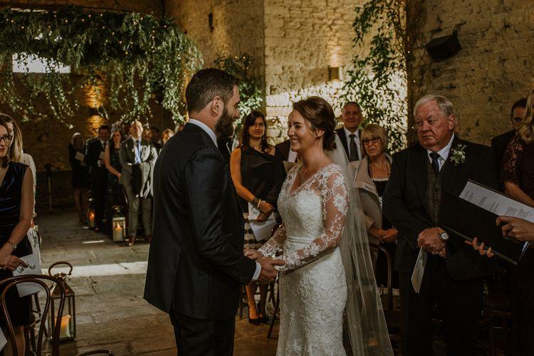 Wedding Ceremony | Bride in Annasul Y Violet Wedding Dress | Groom in Suit Supply | Rustic Cripps Barn Winter Wedding | Alexandra Jane Photography