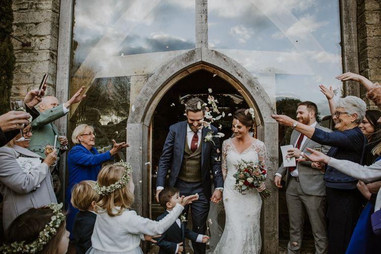 Confetti Moment | Bride in Annasul Y Violet Wedding Dress | Groom in Suit Supply | Rustic Cripps Barn Winter Wedding | Alexandra Jane Photography