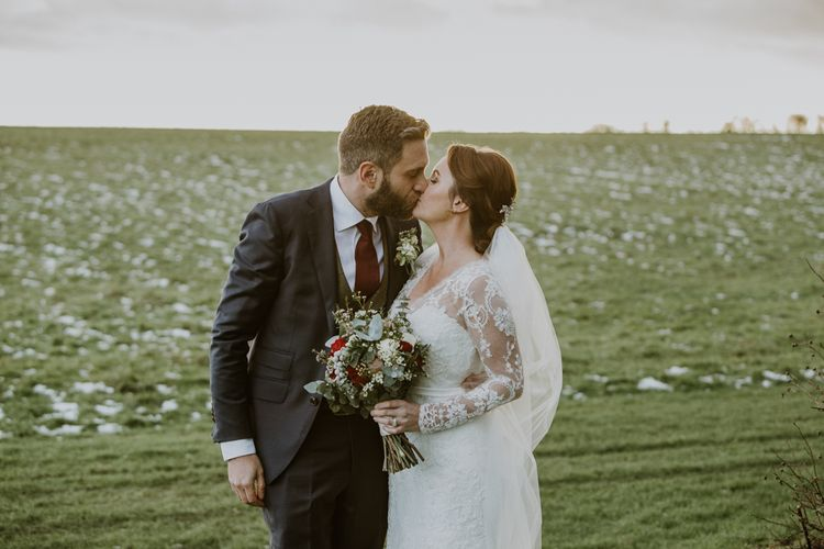 Bride in Annasul Y Violet Wedding Dress | Groom in Suit Supply | Rustic Cripps Barn Winter Wedding | Alexandra Jane Photography