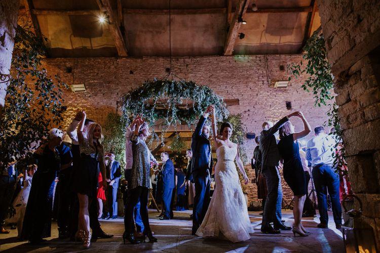 Bride in Annasul Y Violet Bridal Gown | Groom in Suit Supply | Rustic Cripps Barn Winter Wedding | Alexandra Jane Photography