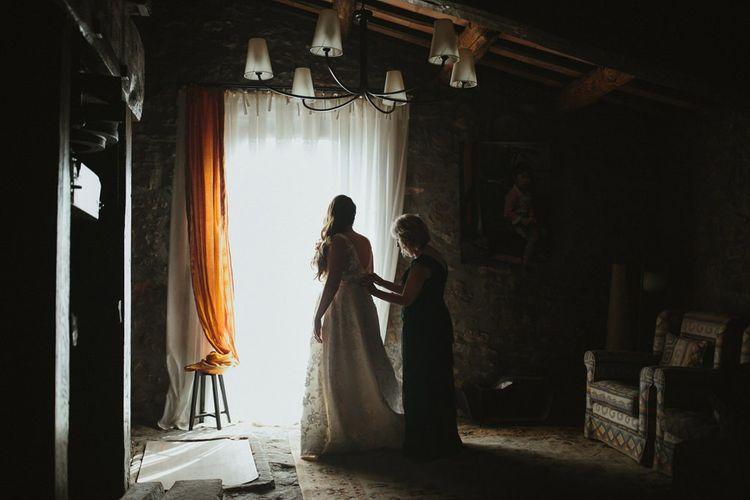 Bride gets into her Jenny Yoo wedding dress