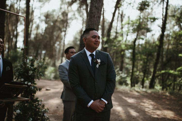 Groom watches bride walk down the aisle