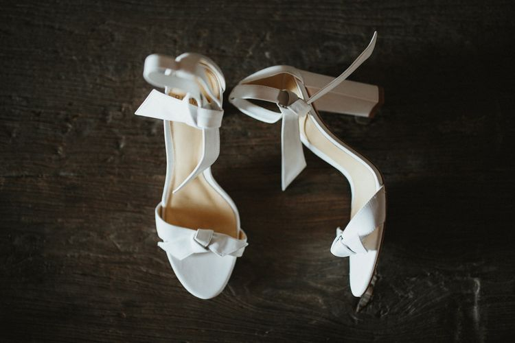 While wedding shoes for bride in Jenny Yoo wedding dress