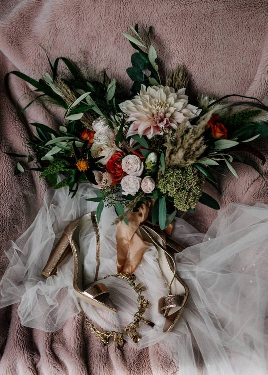 Bridal accessories including gold wedding shoes