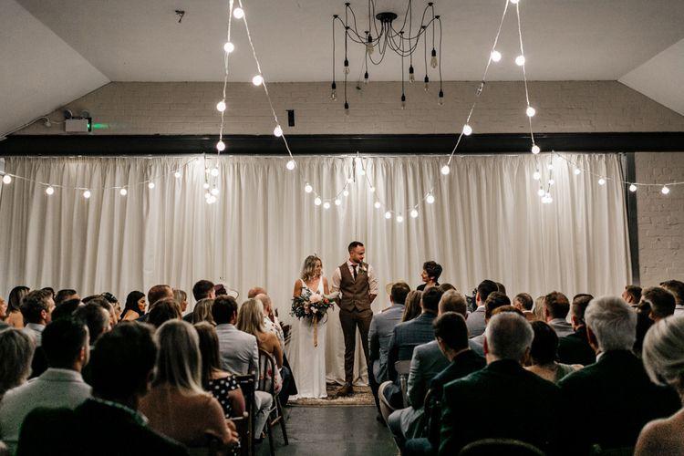 Festoon lit wedding ceremony at New Craven Hall in Leeds