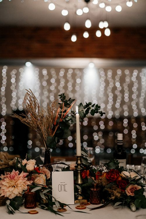 Wedding table decor with flowers and taper candles