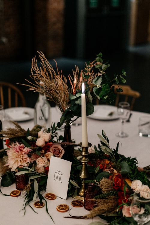 Autumnal wedding flowers with foliage and roses