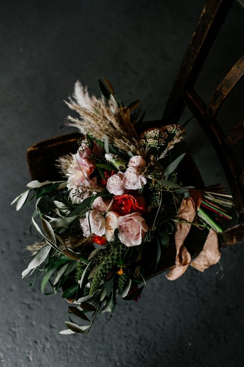 Bridal bouquet with foliage, roses, dahlias and dried grasses