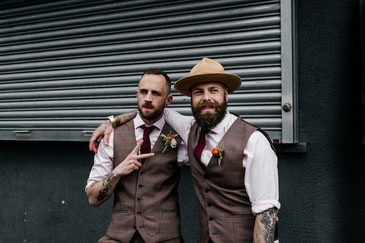 Groom and best man in brown check suits