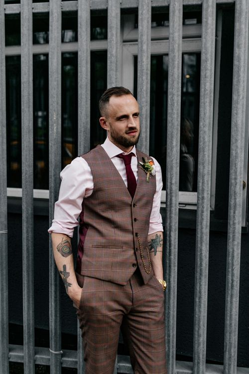 Groom in brown check trousers and waistcoat
