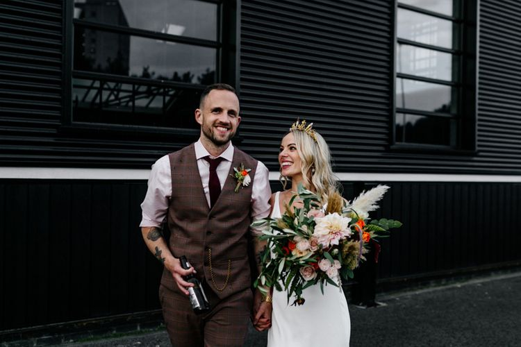 Stylish bride and groom with tattoos