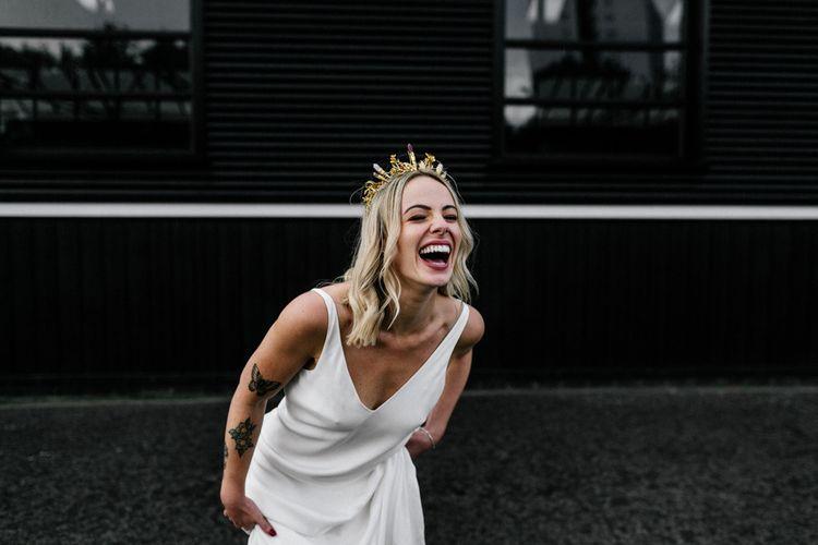 Happy bride in Charlie Brear wedding dress with gold bridal crown