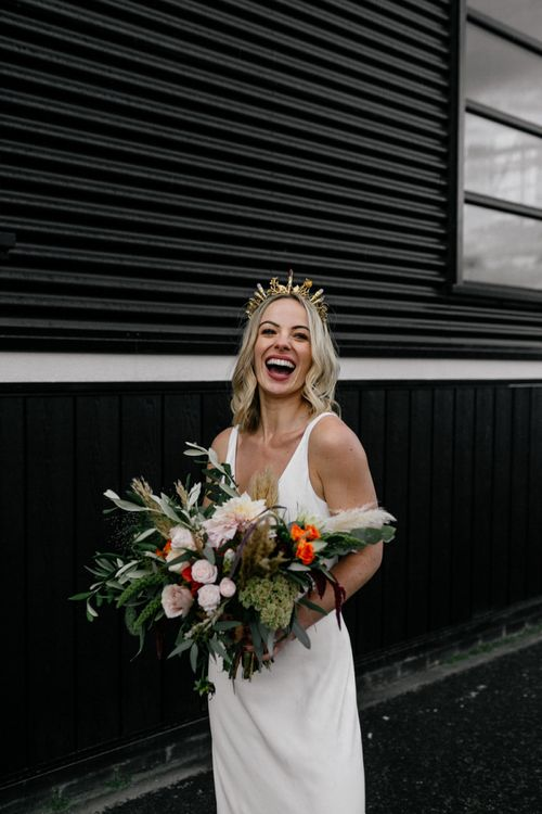 Bride in gold bridal crown laughing