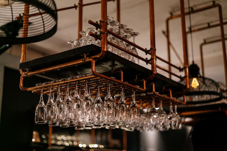 Copper pipe glass holder at Industrial wedding venue