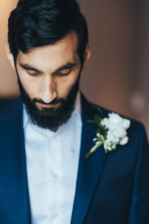 Bearded Groom in Navy Suit with White Flower Buttonhole