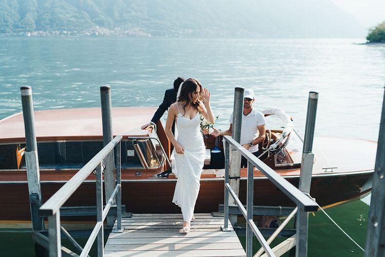 Bride in Grace Loves Lace Mia Wedding Dress Getting Off Boat