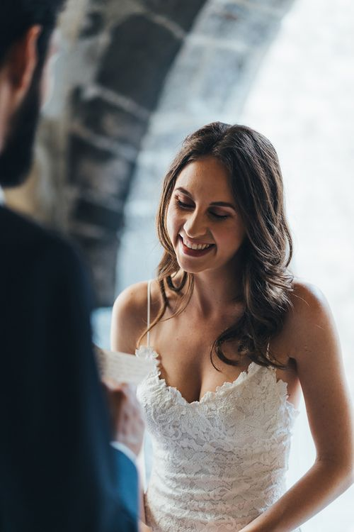 Happy Bride in Grace Loves Lace Mia Wedding Dress Listening to Her Grooms Vows