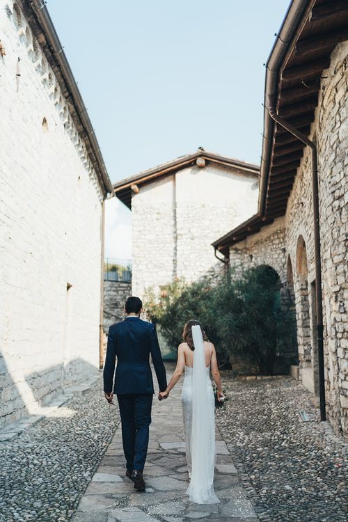 Bride in Grace Loves Lace Mia Wedding Dress and Groom in Taliare Navy Suit