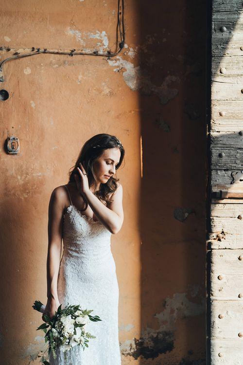 Bride in Mia Grace Loves Lace Wedding Dress