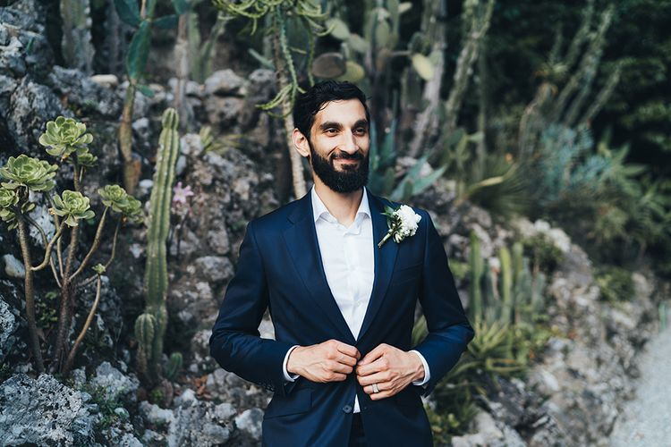 Groom in Taliare Navy Suit and White Shirt