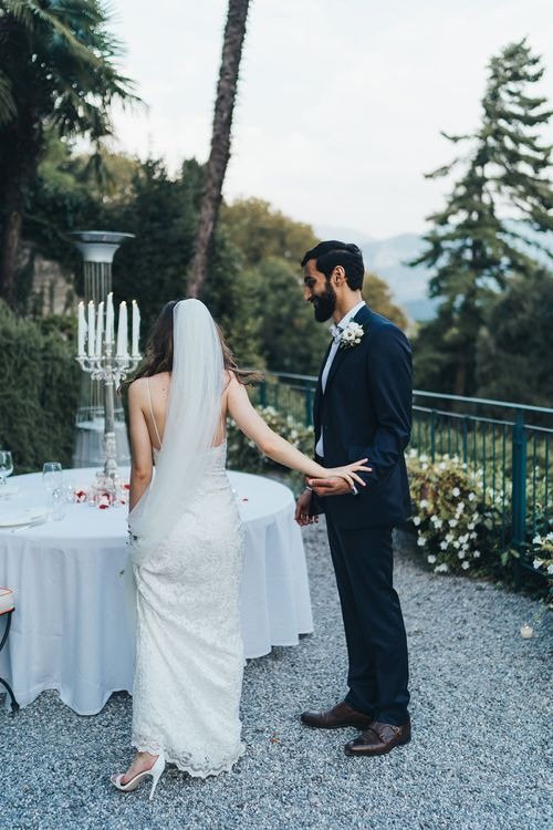 Bride in Grace Loves Lace Mia Wedding Dress and Groom in Taliare Navy Suit at their Intimate Wedding Reception