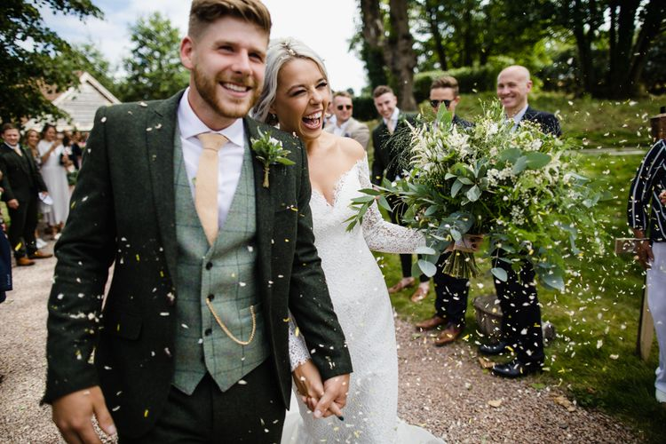 Groom In Green Suit With Waistcoat // Dewsall Court Wedding With Bride In Fishtail Gown 'Adele' By Augusta Jones With Images From Chris Barber Photography And Film From Blooming Lovely Films