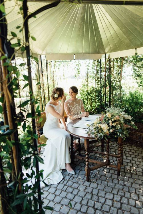 Brides tie the knot at outdoor wedding ceremony with gypsophila  decor
