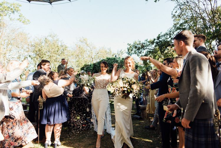 Confetti shot at outdoor wedding ceremony with relaxed decor